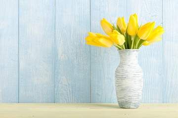 Yellow tulips in a jug