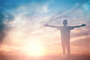 Fototapeta Man celebrating worship god in morning. Christian open hand over sunset inspire praise for peace cross concept for freedom financial, vision and mission, self motivation, hope faith love, stray obraz
