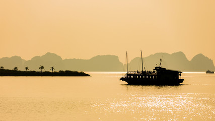 silhouette boat at Halong Bay, Vietnam. Unesco World Heritage Site. Most popular place in Vietnam.
