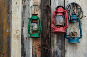 Three Lanterns on Wooden Wall