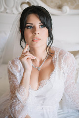 beautiful portrait of young bride in gown in the morning