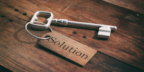 Old key with tag solution on a wooden background. 3d illustration