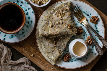Pancakes on the apple juice with poppy seeds nuts and honey