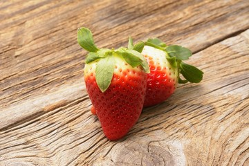 Wall Mural - fresh strawberries on the brown wooden table