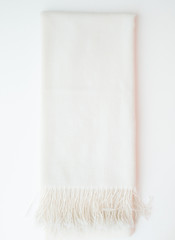 isolated cashmere scarf on white background - studio shot from above