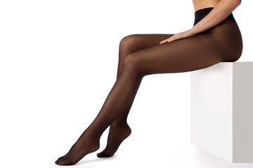 Female legs in black pantyhose