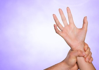Composite image of Hands retaining against purple background