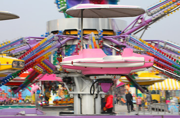nacelle of a carousel as it spins wildly