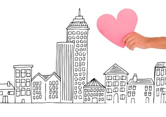 Composite image of Hand holding Heart against city drawing