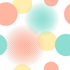 Seamless pattern of circles including halftone effect in colours peach, aqua and yellow