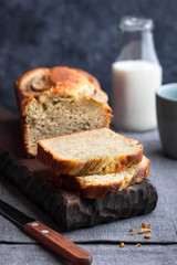Delicious homemade banana bread served with bottle of milk