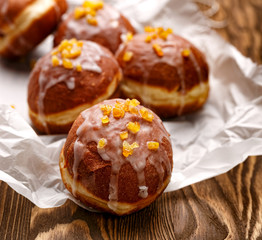 Polish donuts with icing sugar and orange zest