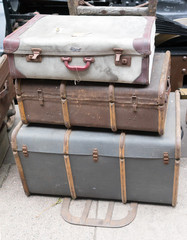 Stack of old luggage cases at a train station