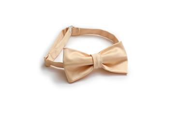 beige satin bow tie on a white background