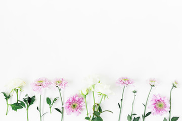 Floral pattern with roses and pink flowers, green leaves and branches on white background. Flat lay, top view. Floral background
