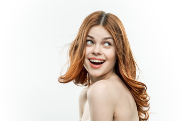 cheerful woman with bare shoulders