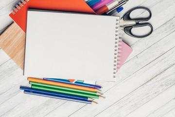 notebooks, pens, colorful pencils, scissors