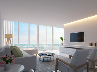Modern white living room with sea view 3d rendering image,Decorate wall with hidden warm light,white furniture,There are large windows Looking to beautiful sea view