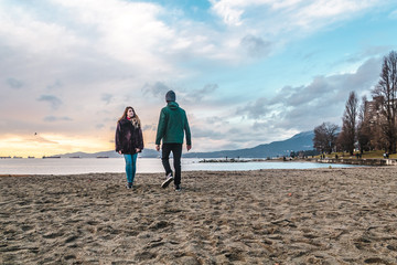 Couple at English Bay Beach Park in Vancouver, Canada