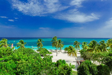 Stunning gorgeous beautiful, amazing view of Holguin province tropical inviting beach and tranquil azure turquoise ocean on blue sky background  Wall mural