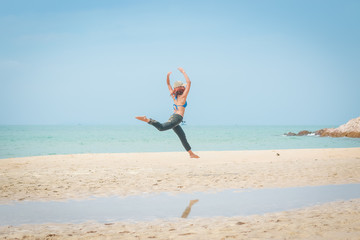 girl jump on  the beach, happy on vacation time