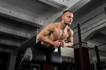 Man Doing Core Exercise On Exercise Equipment