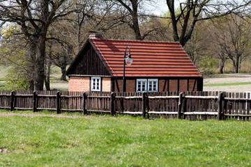 Traditional rural building on sunny spring day. Poland