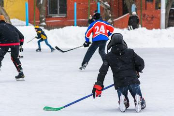 amateur hockey team plays on the ice