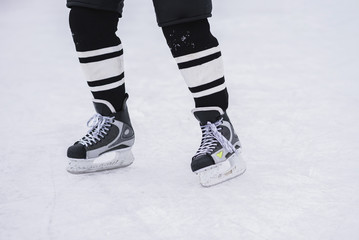 hockey skates close-up during a game on ice