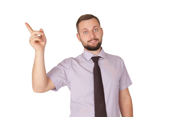 Idea concept, young handsome caucasian businessman points to empty space, isolated on white background.