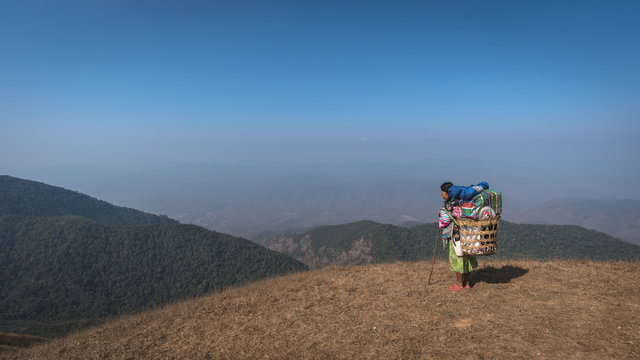 Woman sherpa at the top of mountain, Doi Mon Jong, Thailand