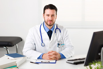 Male doctor in white coat with stethoscope on his neck