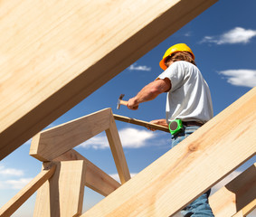 roofer or Carpenter working on Roof on construction site