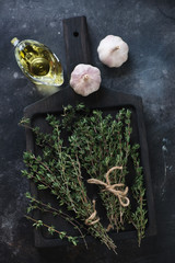 Above view of fresh thyme with garlic and olive oil, studio shot