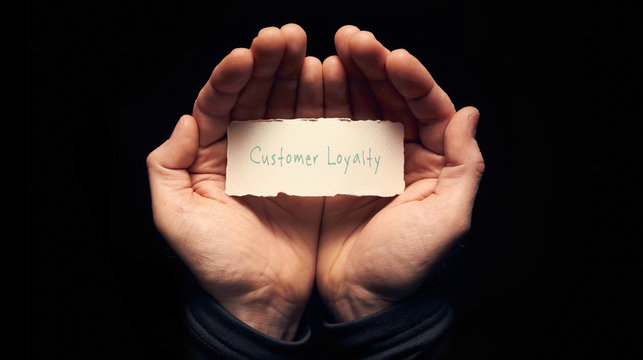Hands holding a Customer Loyalty Concept