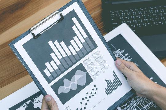 business statistics success concept : businessman analytics marketing chart and graph