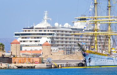 huge sailing ship on the background of two cruise liners at port Rhodes, Greece