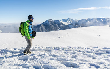 Mountaineer winter trail in the mountains.