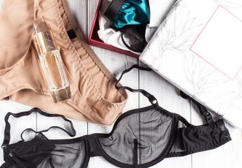 Lacy underwear on wooden white background, bras, panties, box, horizontal, soft focus