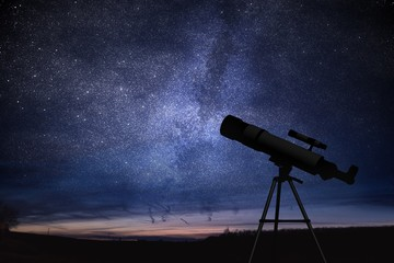 Silhouette of telescope and starry night sky in background. Astronomy and stars observing concept. Wall mural