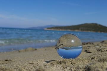 A glassball is on the beach in Kusadasi, Aydin