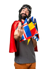 Superhero with a lot of flags coming gesture