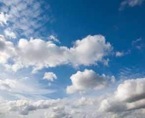 clouds. a visible mass of condensed water vapor floating in the atmosphere, typically high above the ground.