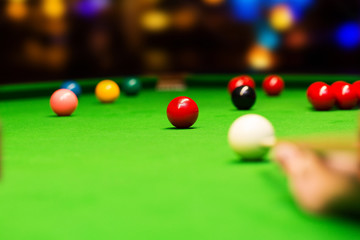 playing snooker in bar