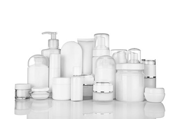 Different cosmetic bottles on white background
