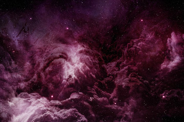 purple nebula and cosmic dust in starry sky