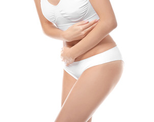 Close up view of young woman suffering from abdominal pain, on white background. Gynecology concept