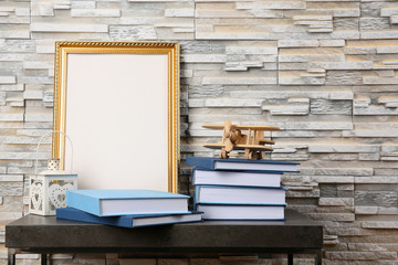Books on table near textured wall