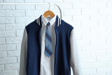 School uniform of teenage boy on hanger