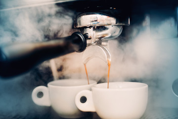 Espresso details. two perfect cups of coffee. Coffee Preparation concept at bar, pub or restaurant.